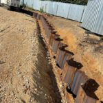 Installing permanent sheet piling with silent vibrating method
